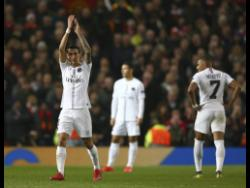 Paris Saint Germain's Angel Di Maria applauds his team's fans as he is substituted during the Champions League round-of-16 match between Manchester United and Paris Saint Germain at Old Trafford stadium in Manchester, England, on Tuesday.