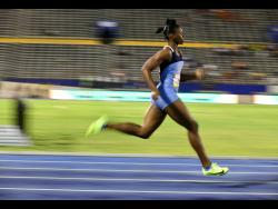 Edwin Allen's Kevona Davis winning her heat in the Class Two girls 200m on the opening day of the ISSA/GraceKennedy Boys and Girls'  Championships at the National Stadium yesterday.