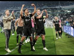 Ajax's players celebrate at the end of the Champions League, quarter-final, second-leg match between Juventus and Ajax, at the Allianz stadium in Turin, Italy, yesterday.
