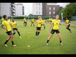 Reggae Girlz  executing a set drills in a training session ahead of their final Group C match against Australia today.
