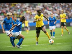Jamaica's Khadija Shaw (right foreground) goes on the attack against Italy's (from left) Elena Linari, Elisa Bartoli and team captain Sara Gama in the Group C FIFA Women's World Cup match at Stade Auguste-Delaune in Reims, France, on Friday June 14. Jamaica lost 5-0.