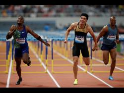 (From left) Jamaica's Omar McLeod, Xie Wenjun (China) and Antonio Alkana of South Africa compete in the men's 110m hurdles during the Diamond League Track and Field meet in Shanghai, China, on Saturday, May 18. McLeod won in 13.12 seconds.