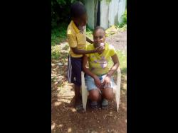 Merrick wipes sweat from his mother Ann-Marie Williams face