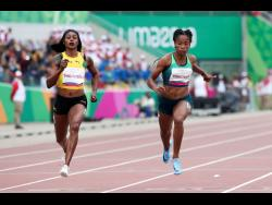 Elaine Thompson of Jamaica finishes first and Vitoria Cristina Silva ofBrazil finishes second in a women's 100m heat during the athletics at the Pan American Games in Lima, Peru yesterday.