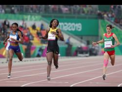 Shericka Jackson of Jamaica (centre) wins the gold medal in the women's 400m at the Pan American Games in Lima, Peru, yesterday.