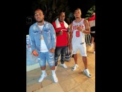 Contributed Producer Damage with dancehall artiste Teejay (left) and footballer Leon Bailey (right).