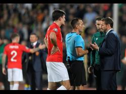 England manager Gareth Southgate (right) speaks with referee Ivan Bebek during the Euro 2020 group A qualifying match between Bulgaria and England, at the Vasil Levski national stadium, in Sofia, Bulgaria, on Monday.