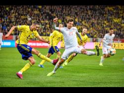 Sweden's Mikael Lustig (left) and Spain's Mikel Oyarzabal in action during their Euro 2020 Group F qualification match between Sweden and Spain at Friends Arena in Solna, Stockholm, Sweden, yesterday.