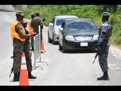 Jamaica Defence Force personnel at a checkpoint in Whitehouse, Westmoreland.