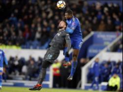 Chelsea's Olivier Giroud is airborne with Leicester City's Wes Morgan (right) during their English FA Cup quarterfinal match at the King Power Stadium in Leicester, England on Sunday, March 18, 2018.