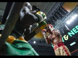 File Richard Holmes (left) leans against the ropes as Ricardo Salas attacks in the final of the Wray and Nephew Contender 2018 competition.