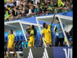 Matthews (left) enjoys a moment with her then nine month old som after a FIFA Women's World Cup match againts Australia on June 18, 2019.