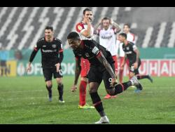 Bayer Leverkusen's Leon Bailey celebrates after scoring his side's first goal during the German Soccer Cup third-round match against RW Essen  in Essen, Germany, yesterday.
