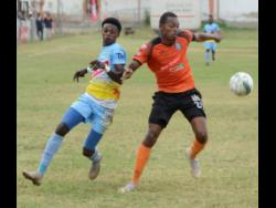 FILE Denardo Thomas (left) from Waterhouse and Andre Moulton (right) from Tivoli Gardens both try to win the ball during a Red Stripe Premier League football match at the Edward Seaga Oval on Sunday, March 17, 2019.
