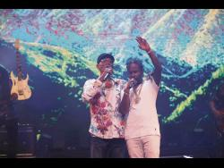 Surprise guest for the show, Popcaan (right) gets caught up in his performance with Beres.