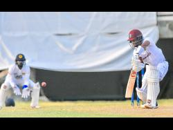 West Indies batsman Shai Hope in action for the Cricket West Indies President's XI against Sri Lanka in a warm-up match at the Coolidge Cricket Ground in St John's, Antigua, yesterday.