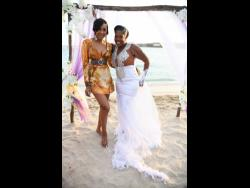 Fellow dancehall artiste and close friend of the bride, D'Angel, was at Saturday's 'Royal' wedding. Here she shares the spotlight with the newly-minted Mrs 'Queenie' Scarlett.