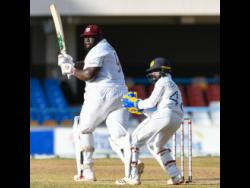 West Indies all-rounder Rahkeem Cornwall plays a shot down the leg side during his unbeaten knock of 60 runs on day two of the first Test against Sri Lanka in Antigua yesterday.