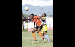 Tivoli Gardens FC's Junior McGregor jostles for the ball with Waterhouse FC's Tramaine Stewart (right) in their Red Stripe Premier League game at the Edward Seaga Complex on Sunday, March 4, 2018.