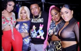 The man of the night, Ikel Marvlus, hangs out with (from left) Poochie, Jodi, Renee SixThirty and Sher Luxury Doll.
