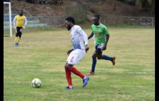 Portmore United's Ricardo Morris dribbles away from John Barrett of Montego Bay United in their Red Stripe Premier League match at WesPow Park yesterday. Portmore won 5-1.