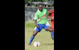 Ian Allen Dino Williams of MoBay United.
