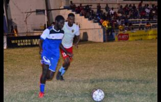 Brown's Town FC's Romario Ward (left) dribbles away from Central Kingston FC's captain, Donovan Alvaranga, during their recent first-round Magnum KSAFA Super League football match at the Harbour View Mini-Stadium.