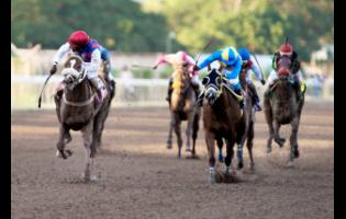 Robert Halladeen (left) wins last year's Diamond Mile aboard Will In Charge.