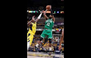 AP Boston Celtics guard Kyrie Irving (11) shoots over Indiana Pacers guard Darren Collison (2) during the first half of Game 4 of an NBA basketball first-round playoff series in Indianapolis on Sunday.