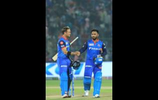 Delhi Capitals' Rishabh Pant (right) shakes hands with Colin Ingram after winning the VIVO IPL T20 cricket match against Rajasthan Royals in Jaipur, India yesterday.