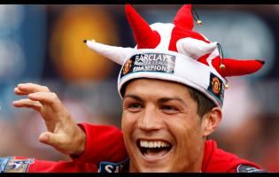 FILE  In this Saturday May 16, 2009 file photo, Manchester United's Cristiano Ronaldo smiles as the team celebrate winning the English Premier League after their 0-0 draw against Arsenal at Old Trafford Stadium, Manchester, England. Ronaldo, who joined Juventus for this season from Real Madrid, became the first player to win the English Premier League (with Manchester United), the Spanish league (with Madrid) and Serie A.