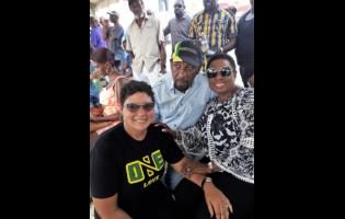 Member of Parliament for South East Clarendon Rudyard Spencer (centre) lymes with People's National Party caretaker for the constituency, Patricia Duncan Sutherland (left), and Minister of Sport Olivia Babsy Grange.