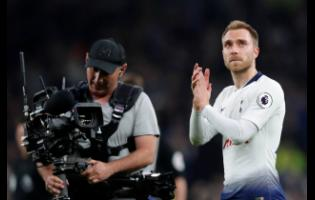 Tottenham's Christian Eriksen greets fans after the English Premier League soccer match  against Brighton & Hove Albion in London yesterday.