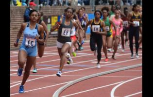 Edwin Allen High School's Rushana Dwyer  (left) leads the pack in the High School Girls' 4x400m relay event at the Penn Relays at the Franklin Field, in Philadelphia, Pennsylvania, yesterday.