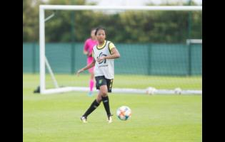 Chantel Hudson-Marks passes the ball during a Reggae Girlz training session at the Centre de Vie Raymond Kopa in Reims, France, on Monday.