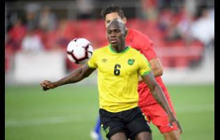 Jamaica forward Dever Orgill (6) watches the ball against United States defender Omar Gonzalez (back) during the second half of an international friendly soccer match, last Wednesday.