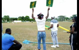 A young spectator celebrates a boundary at a SDC/Wray & Nephew T20 match at Goodyear Oval in St Thomas last month.