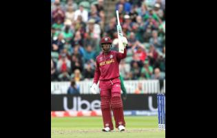 West Indies' Shimron Hetmyer celebrates reaching 50 during the Cricket World Cup match between West Indies and Bangladesh at the Taunton County Ground, Taunton, southwest England,  on Monday June 17, 2019.