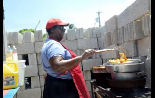 Lesma Hewitt, the all-island 2018 CB pan chicken CB champion  prepares fried potatoes for the fans who turned up to watch the SDC Wray & Nephew T20 Community cricket at  Sir P's Oval in Clarendon, yesterday.