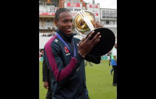 England's Jofra Archer, born in Barbados, celebrates with the Cricket World Cup trophy at the Oval in London yesterday.