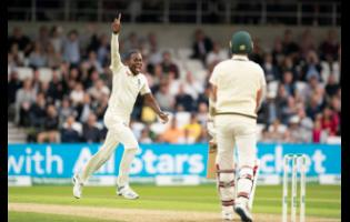 England's Jofra Archer celebrates after taking his fifth wicket, that of Australia's Pat Cummins (right) caught by Jonny Bairstow for 0 on the first day of the third Ashes Test cricket match between England and Australia at Headingley cricket ground in Leeds, yesterday.