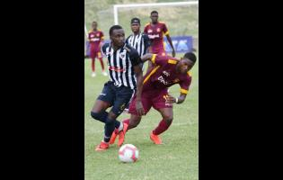Jamaica College's Nickache Murray (left) turns past former Wolmer's Boys School teammate Orlando Russell during their ISSA/Digicel Manning Cup game at the Stadium East field on Monday, September 16, 2019.