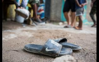 A pair of slippers worn by one of the deceased was still at the crime scene.