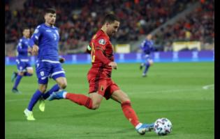 Belgium's Eden Hazard kicks the ball during the Euro 2020 Group I qualifying match between Belgium and Cyprus at the King Baudouin stadium in Brussels, yesterday.