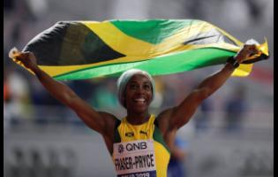 Shelly-Ann Fraser-Pryce celebrates after winning the gold medal in the women's 100 metres final at the World Athletics Championships in Doha, Qatar, on September 29, 2019.