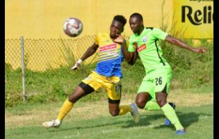Harbour View's Damion Thomas (left) challenges Molynes United's Romario Campbell for the ball during their Red Stripe Premier League match at the Constant Spring  playing field on November 27.