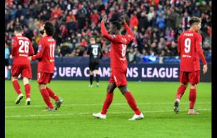 Liverpool's Naby Keita, centre, celebrates after scoring his side's opening goal during the group E Champions League match between Salzburg and Liverpool yesterday.