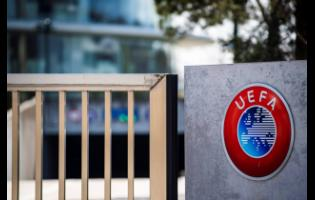AP The UEFA logo displayed at the entrance of its headquarters in Nyon, Switzerland.