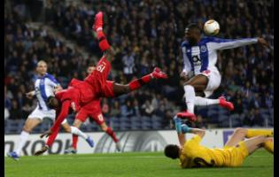 Porto's Chancel Mbemba (upper right) and Porto's goalkeeper Agustin Marchesin (lower right) defend against Leverkusen's Moussa Diaby during the Europa League round of 32 second-leg soccer match between FC Porto and Bayer Leverkusen at the Dragao stadium in Porto, Portugal, Thursday, February 27, 2020.