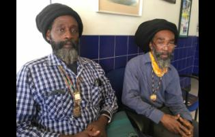 Christopher Graham (left) and Junior Anderson are advocating for one of their Rastafarian role models to be buried in National Heroes Park.